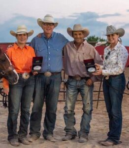 Karen Wallace and Hannah Livingston receive their Rookie Buckles from JP Bell and Mike Hansen